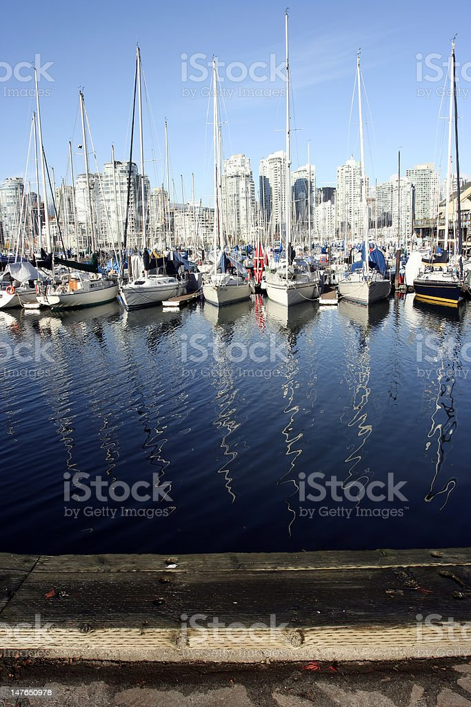 Boats in Marina with masts reflecting royalty-free stock photo