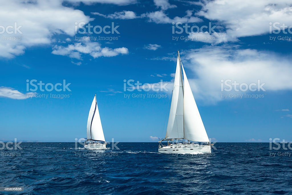 Boats in sailing regatta. Luxury yachts. stock photo