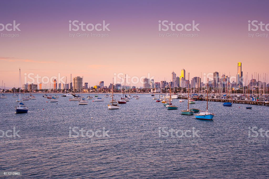 Boats in St. Kilda harbour with Melbourne skyline behind stock photo