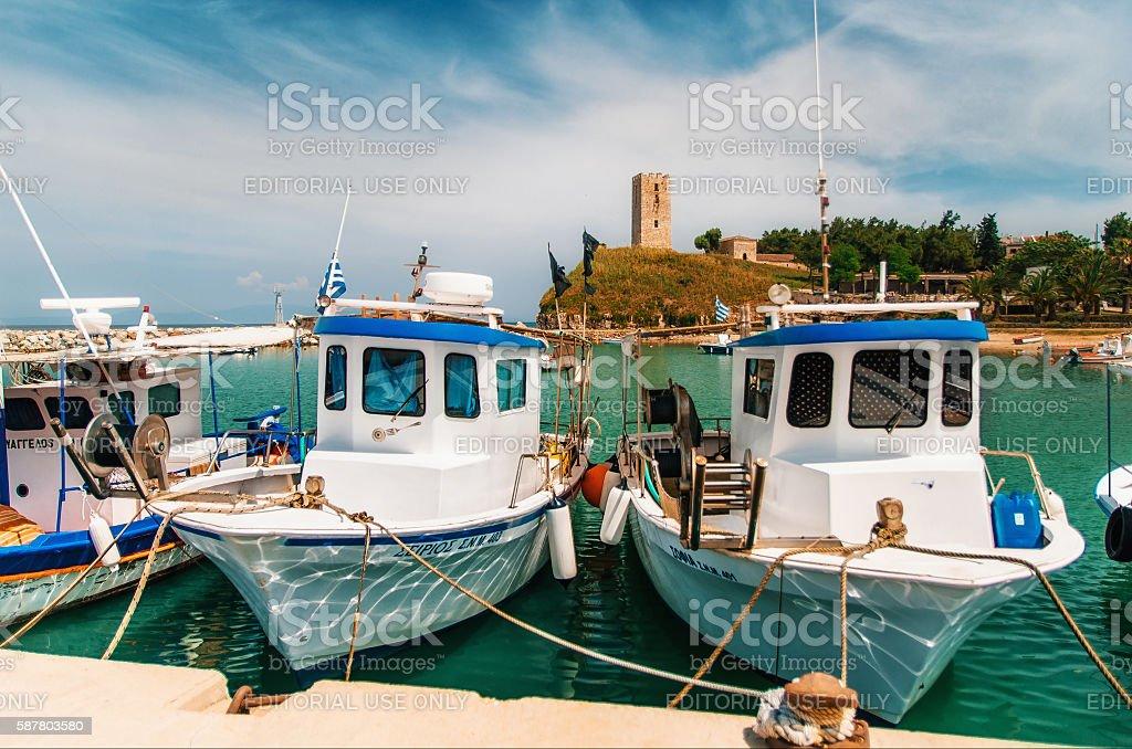 Boats in the background of Nea-Fokea Tower, Halkidiki стоковое фото