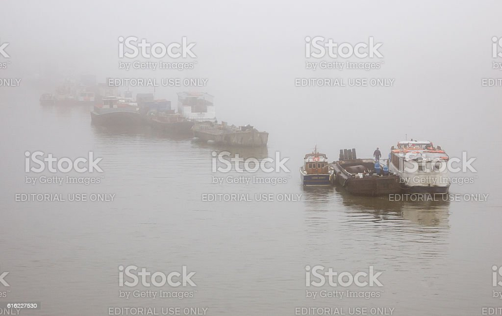 Boats in the fog on the River Thames stock photo