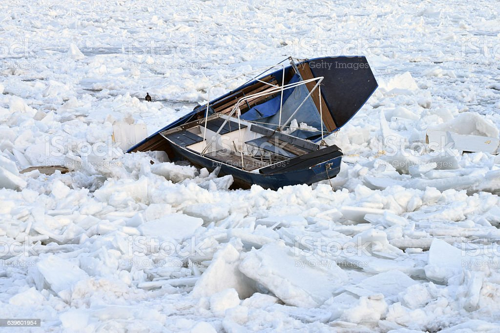 Boats in the frozen river stock photo