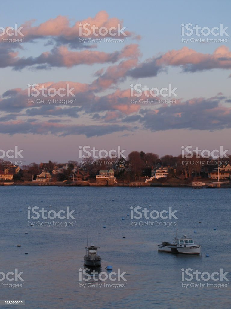 Boats in the harbor on a cloudy day stock photo