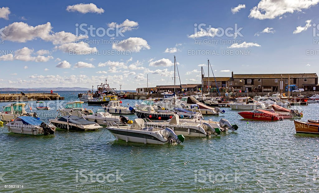 Boats In The Harbour At Lyme Regis Dorset stock photo