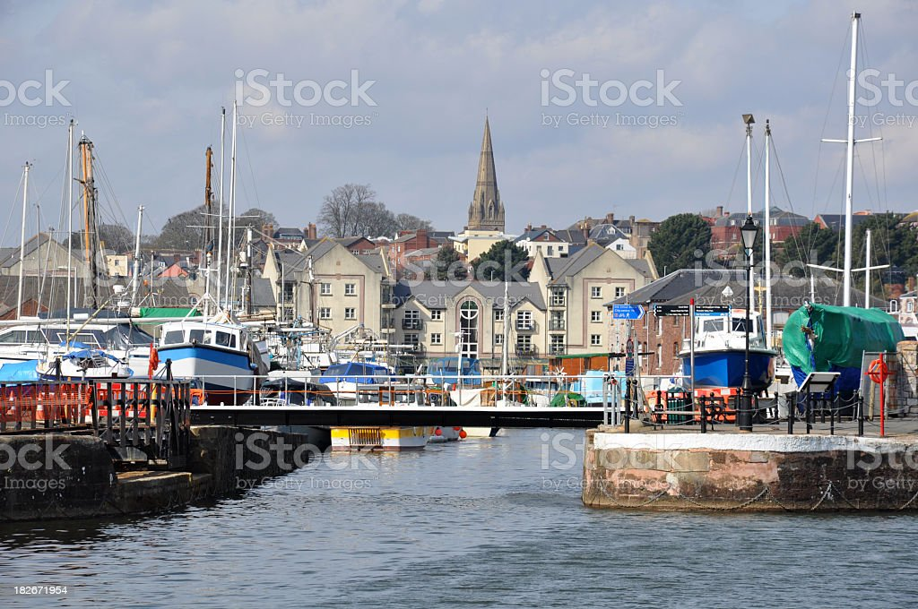 Boats in the quay against the Exeter skyline stock photo