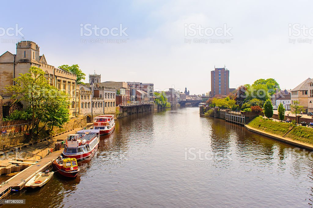 Boats in the river next to the buildings of York stock photo