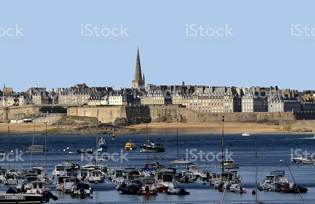 Boats in water off the shore of Bretagne, France stock photo