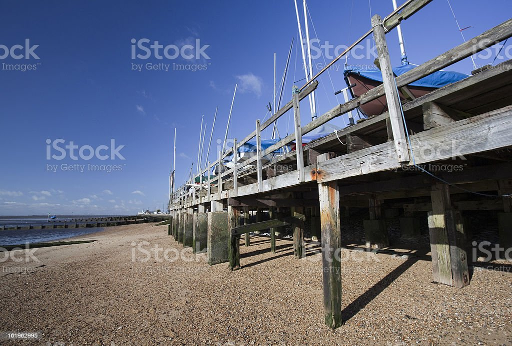 Boats in winter storage on Southend Beach, Essex, England royalty-free stock photo