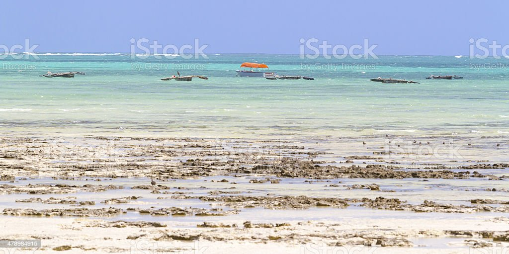 Boats in Zanzibar with low tide stock photo