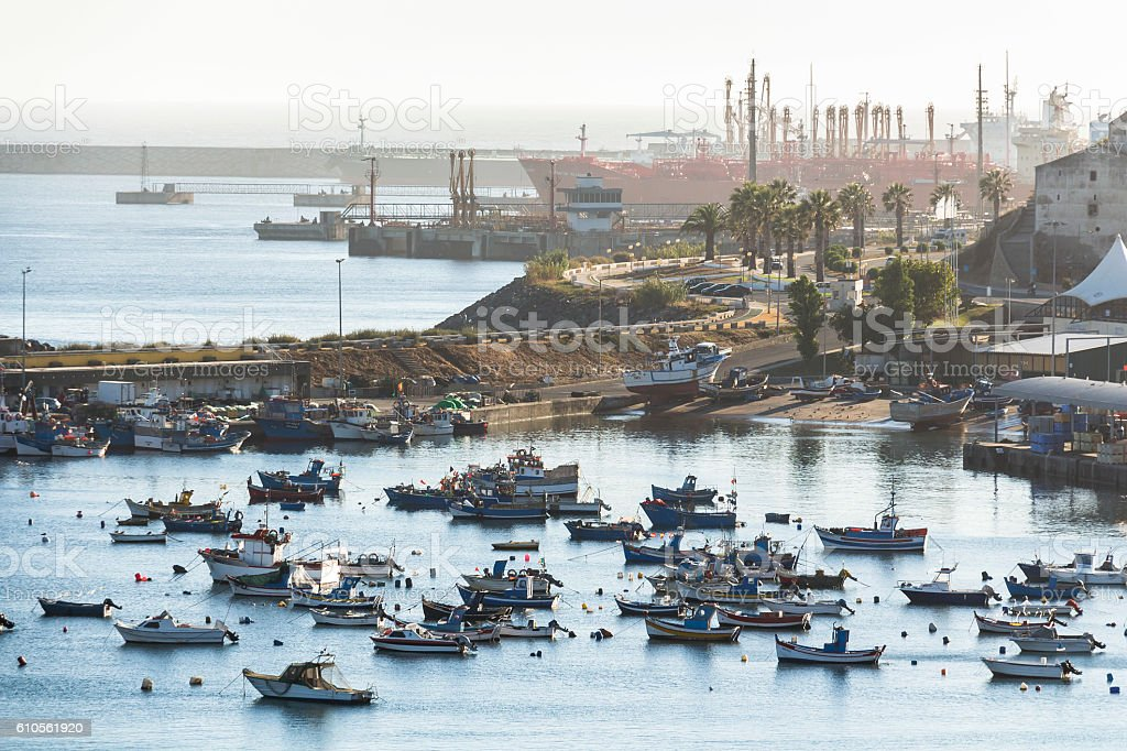 Boats laying in small harbour of Sines, Portugal stock photo