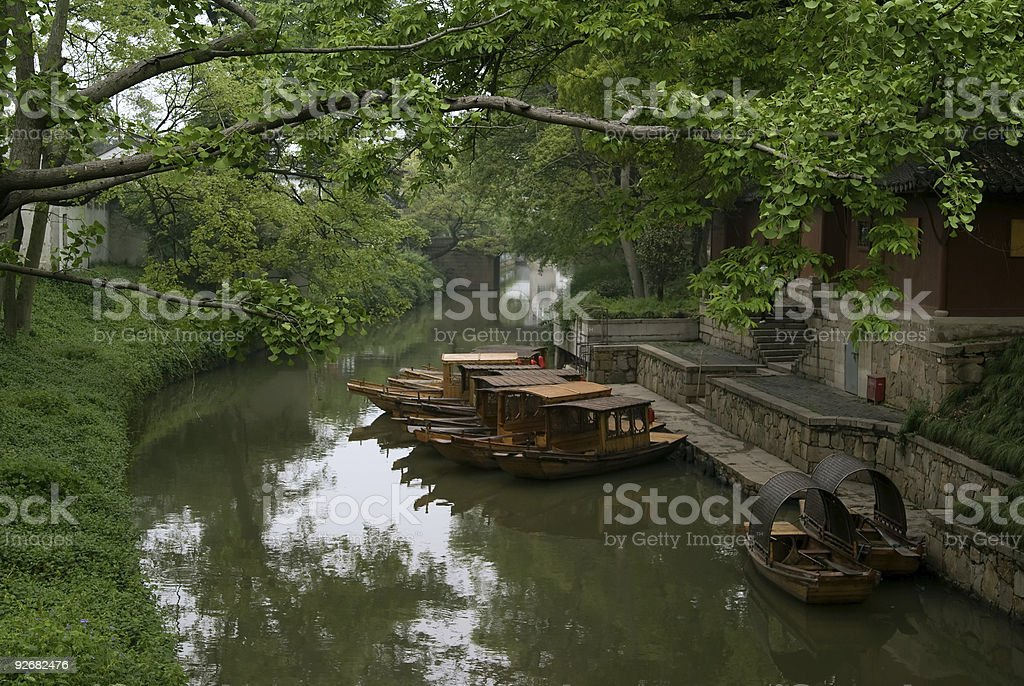 Boats lined outside a house royalty-free stock photo