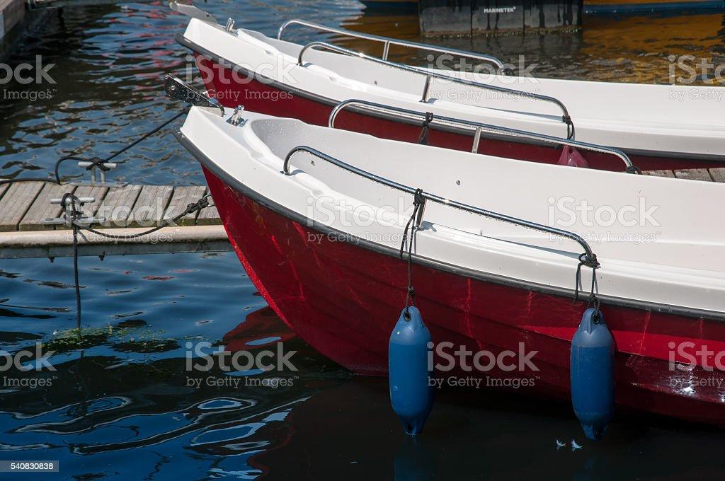 Boats moored at the marina stock photo