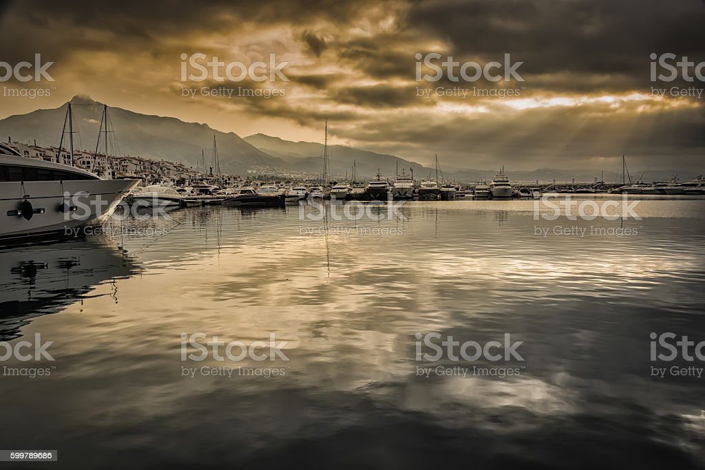 Boats moored in port due to the risk of storm stock photo