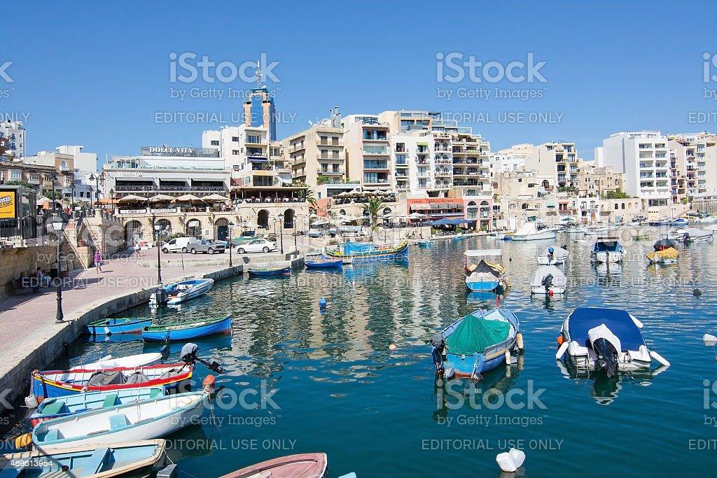 Boats moored in Spinola bay stock photo
