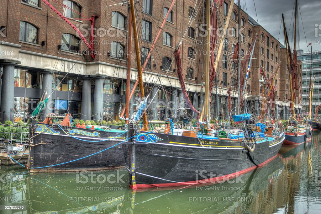 Boats moored in St Katherine docks London stock photo