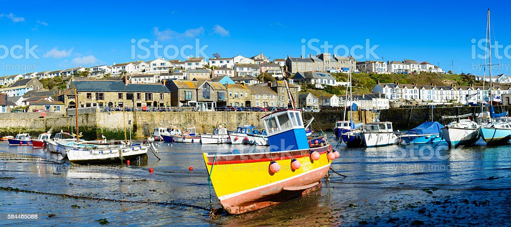 Boats moored in the harbour of Porthleven Cornwall UK stock photo
