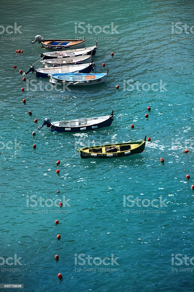 Boats Moored in Vernazza Harbor in Cinque Terre, Italy stock photo