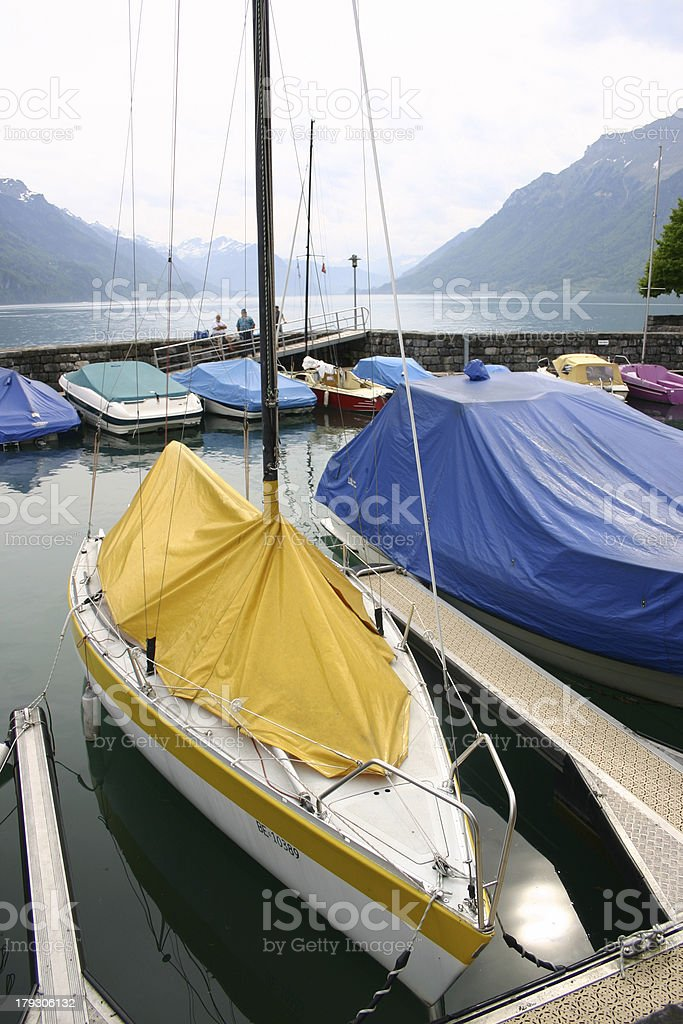 Boats moored on lake Brienz royalty-free stock photo