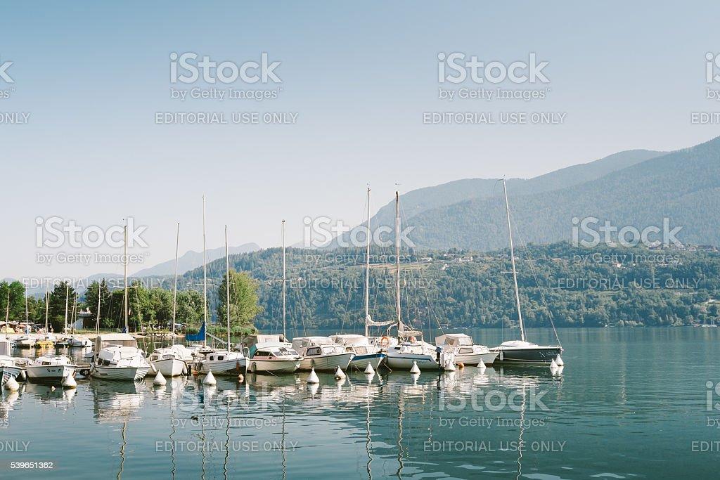 Boats moored on Lake Levico, Trento. stock photo