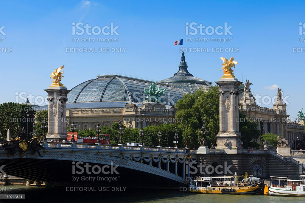 boats next to the Pont Alexandre III in Paris stock photo