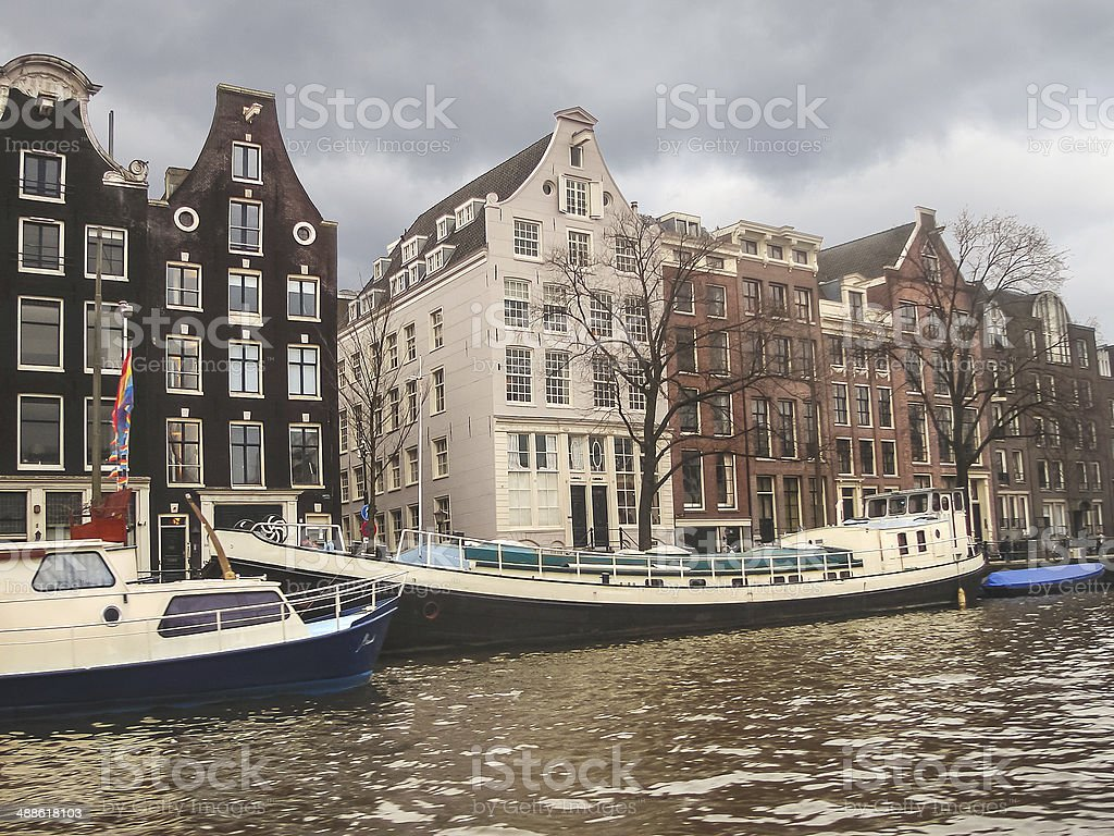 Boats on a canal in Amsterdam. Netherlands stock photo