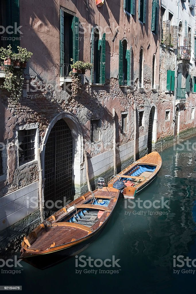 Boats on Backwater Canal in Venice royalty-free stock photo