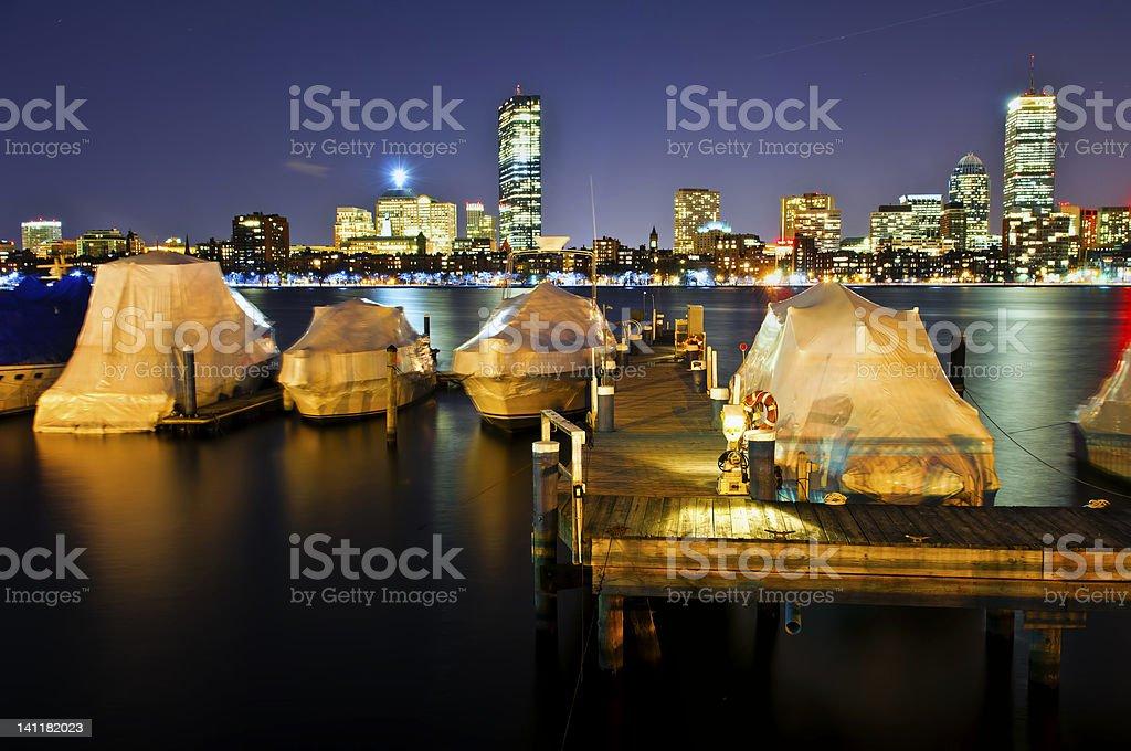 Boats on Boston Charles River  at night royalty-free stock photo