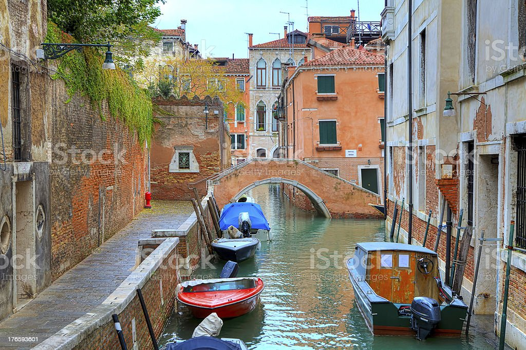 Boats on canal among houses. Venice, Italy. royalty-free stock photo