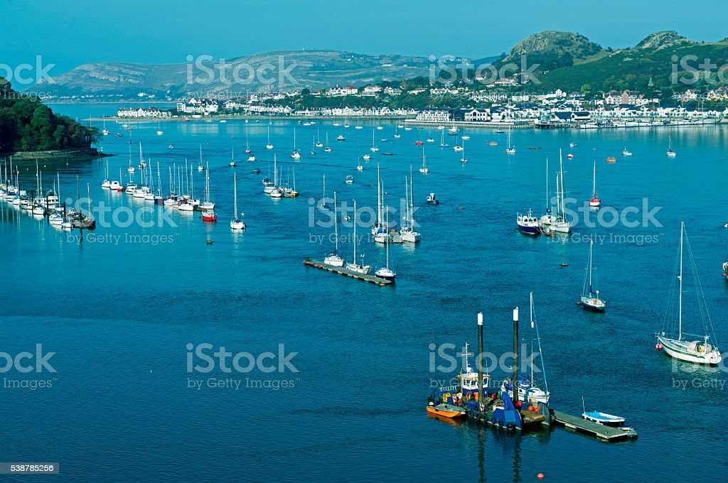 Boats on Conwy Bay and Deganwy in North Wales UK stock photo