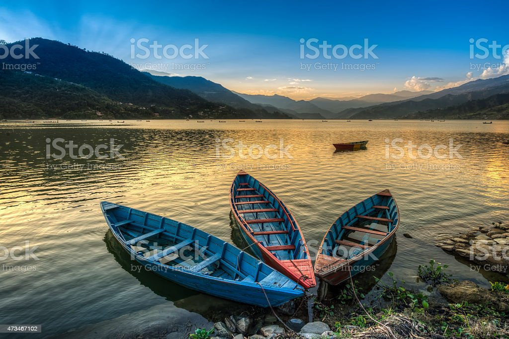 Boats on fewa lake in pokhara, nepal stock photo