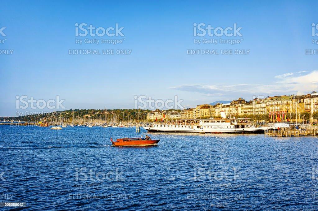 Boats on Geneva Lake at Promenade du Lac in summer stock photo