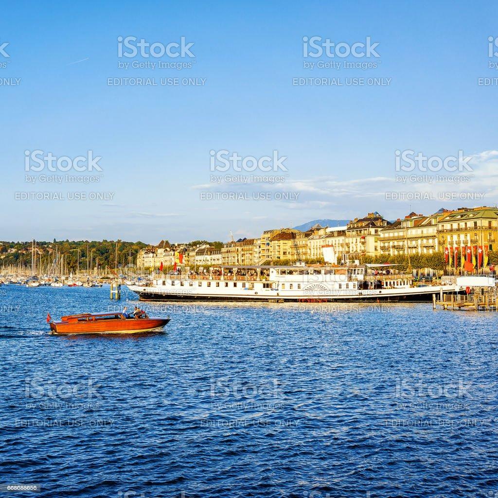 Boats on Geneva Lake near Promenade du Lac in summer stock photo