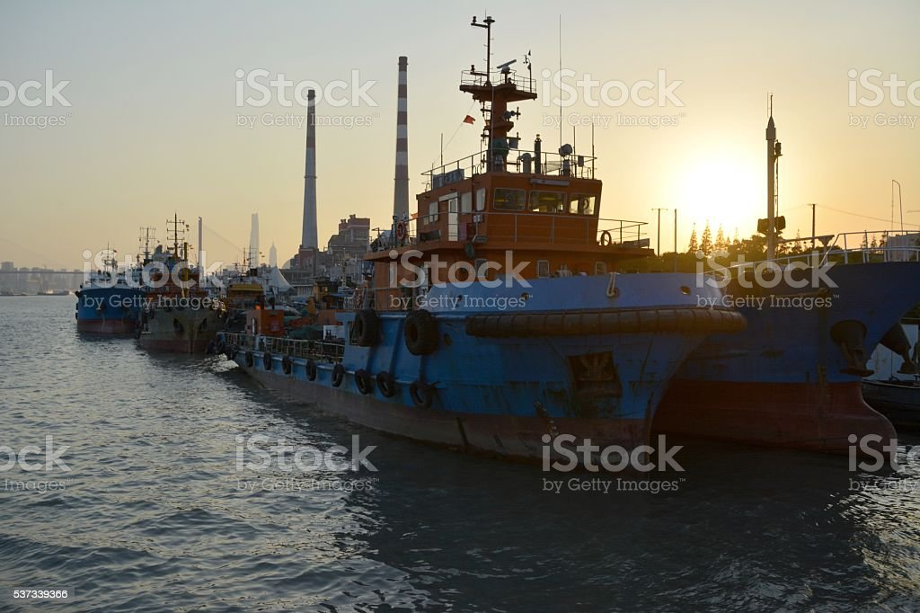 Boats on Huangpu riverside at sunset, Shanghai, China stock photo