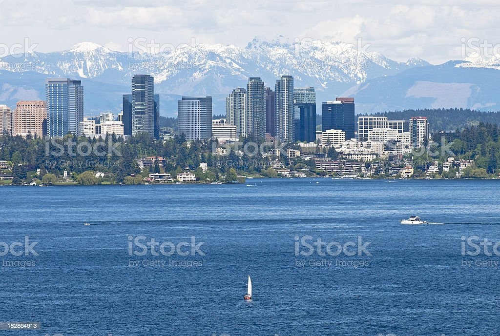 Boats on lake and city stock photo