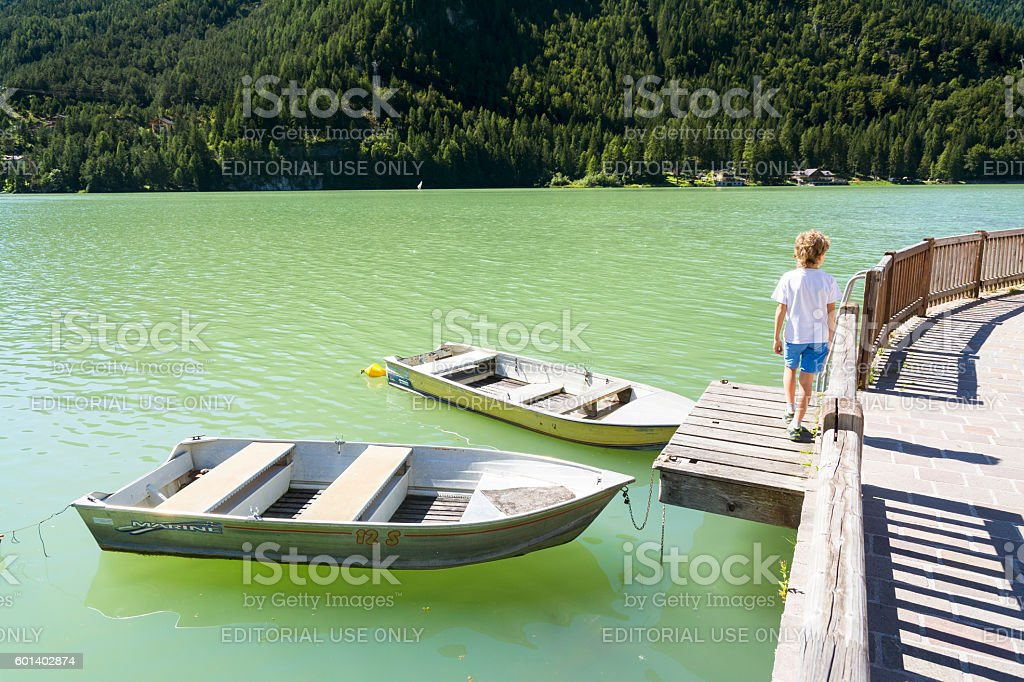 Boats on Lake of Alleghe stock photo