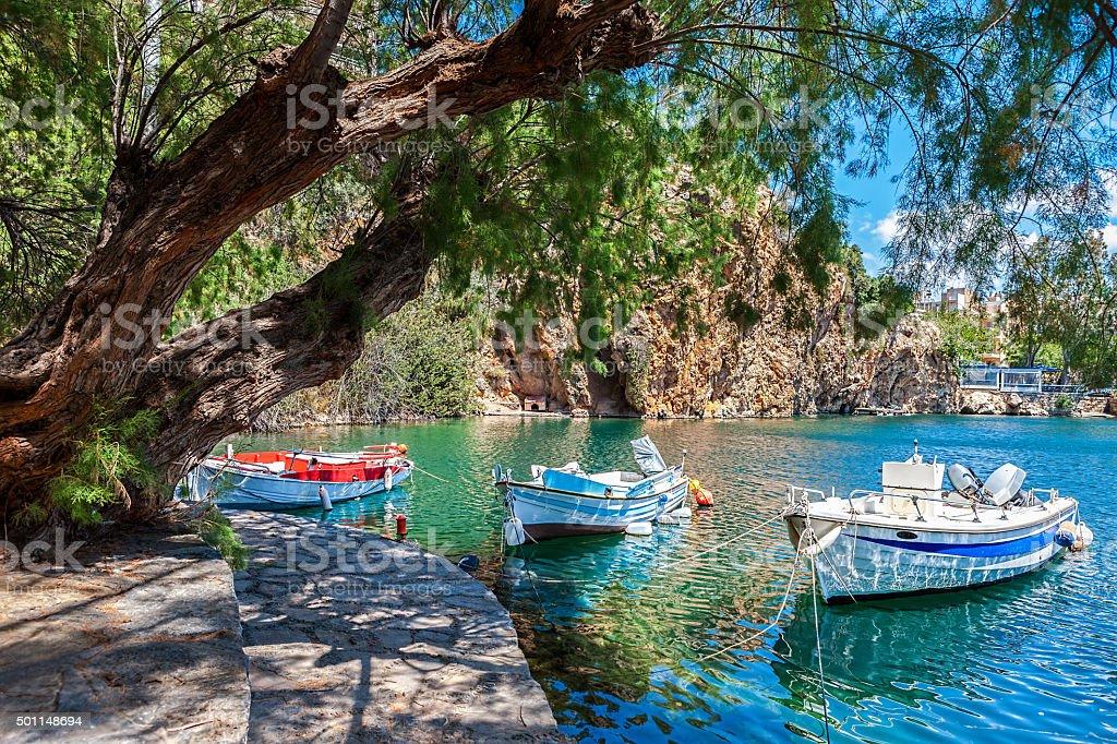 Boats on Lake Voulismeni. Agios Nikolaos, Crete, Greece stock photo
