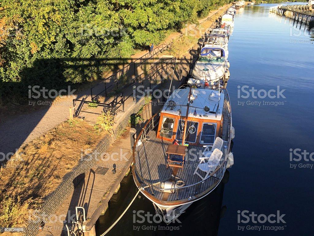 Boats on River Thames near Teddington Lock stock photo