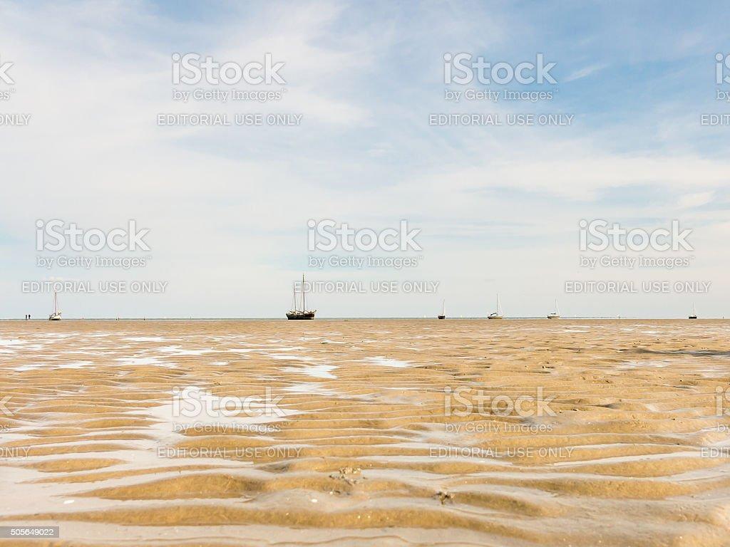 Boats on sand flats Wadden Sea stock photo