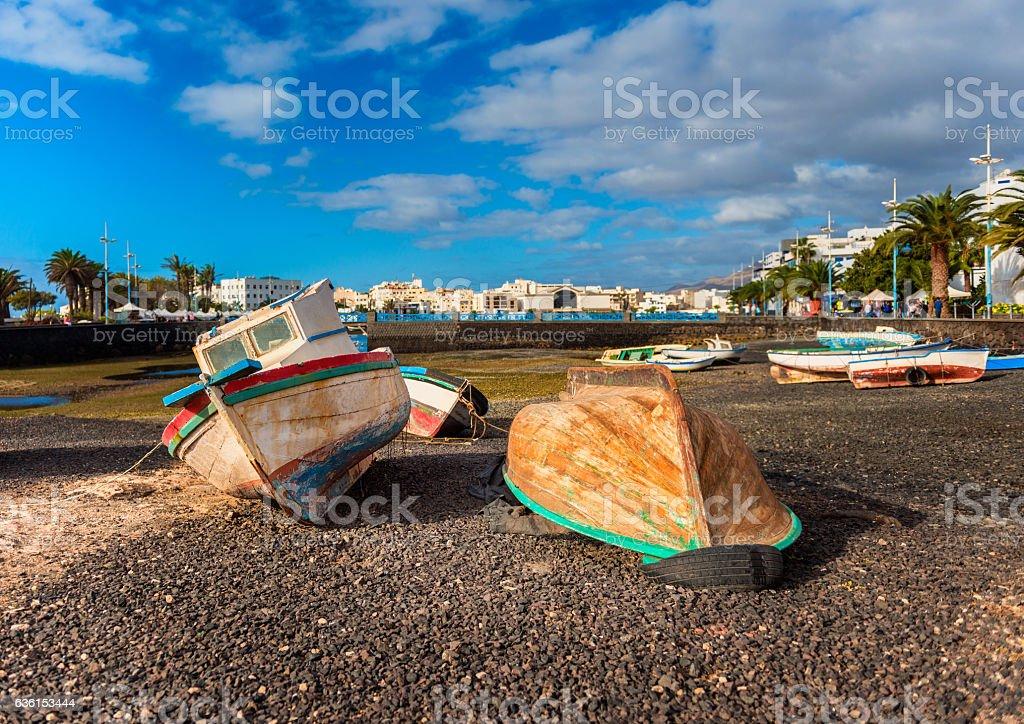 Boats on shore in Arrecife Lanzarote stock photo