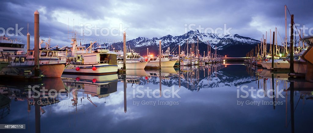 Boats on Smooth Reserection Bay Seward Alaska Harbor Marina stock photo