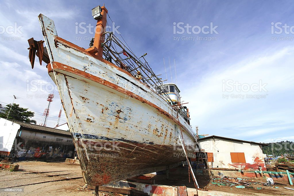 Boats on stands, repair yard stock photo