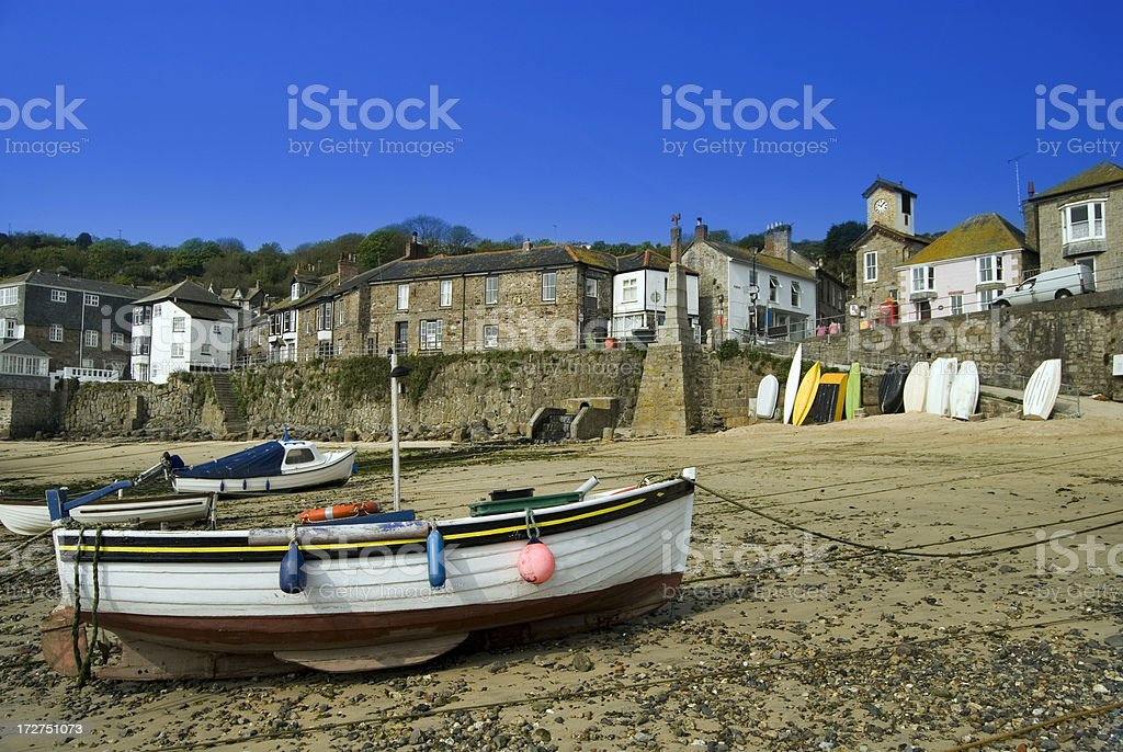 Boats on the beach, at Mousehole Fishing Village.  royalty-free stock photo