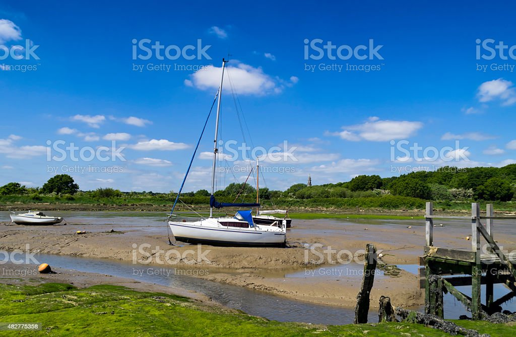 Boats on the mud at Holbrook Creek stock photo