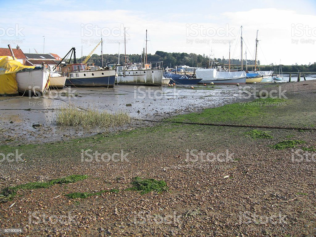 Boats on the mud : low tide at Woodbridge, Suffolk stock photo