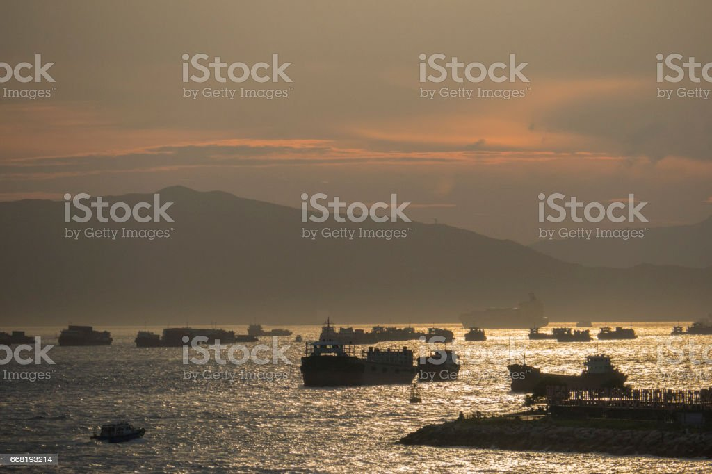 Boats on Victoria Harbour near West Kowloon, Hong Kong, at sunset stock photo