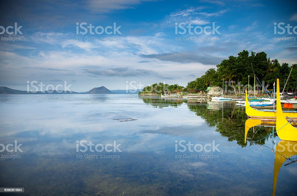 Boats on Volcanic Lake in The Philippines stock photo