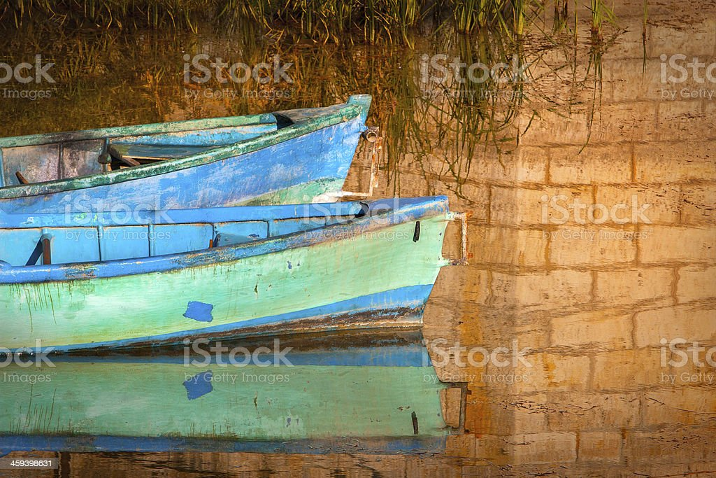 boats on water with stone bridge's reflection royalty-free stock photo