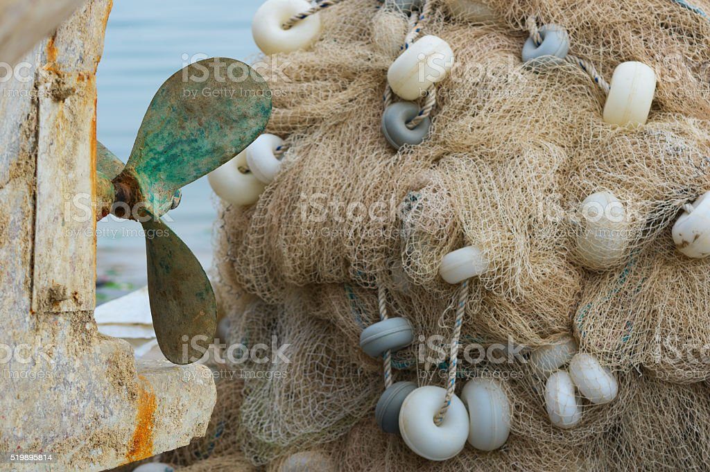 Boat's propeller and Commercial Fishing Net stock photo