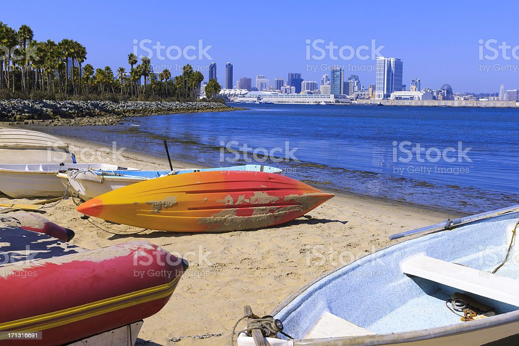 Boats rest on sandy shore of San Diego (P) stock photo