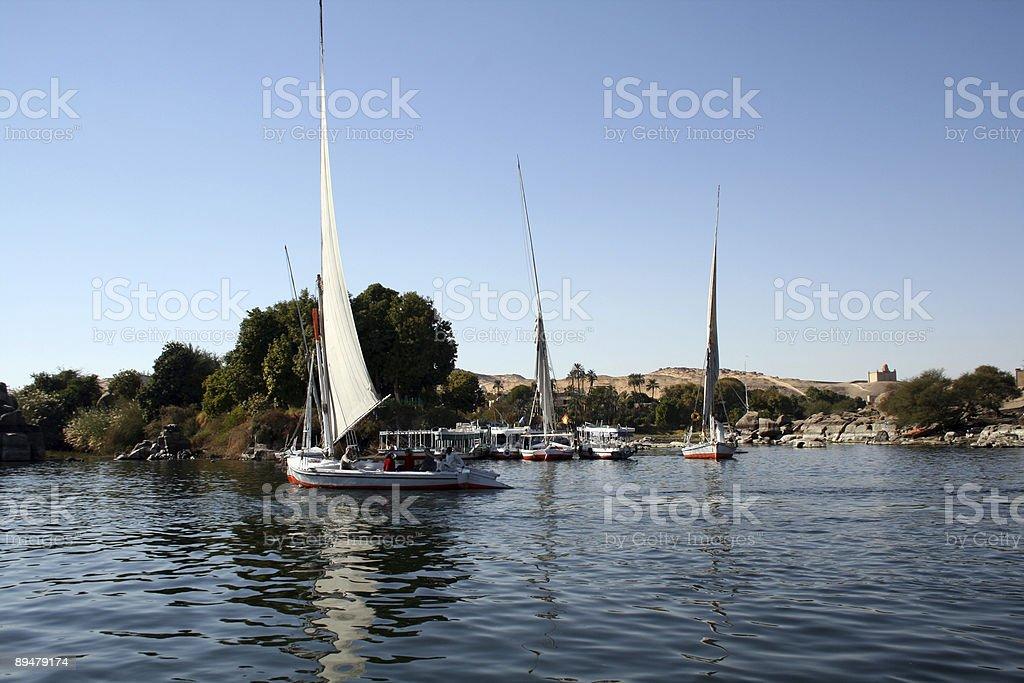 Boats sailing in Aswan river nile royalty-free stock photo